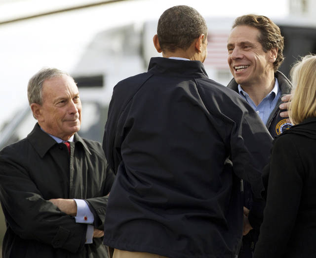 <p>FILE - In this Nov. 15, 2012 file photo, President Barack Obama, center, is flanked by New York City Mayor Michael Bloomberg, left, and New York Gov. Andrew Cuomo, after the president arrived at John F. Kennedy International Airport in New York, to visit areas devastated by Superstorm Sandy. Experts in leadership and disaster response give Bloomberg, Cuomo and New Jersey Gov. Chris Christie high marks for their performance so far in Superstorm Sandy, a disaster that left more than 100 people dead and presented perhaps the biggest crisis-management test yet for the three Northeastern politicians who have all been rumored to hold presidential ambitions. (AP Photo/Carolyn Kaster, File)</p>