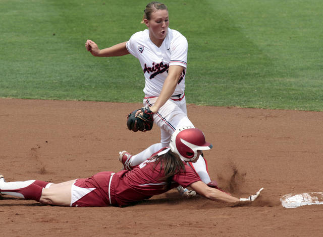 OU / COLLEGE SOFTBALL / NCAA SUPER REGIONAL: Oklahoma's Brianna Turang is called out running back to second on a tag by Shelby Pendley as the University of Oklahoma Sooner softball team plays Arizona in game two of the NCAA Softball Norman Super Regional at Marita Hynes Field on Saturday, May 26, 2012, in Norman, Okla.  Head coach Patty Gasso approached the umpire and argued for a safe runner.  Photo by Steve Sisney, The Oklahoman
