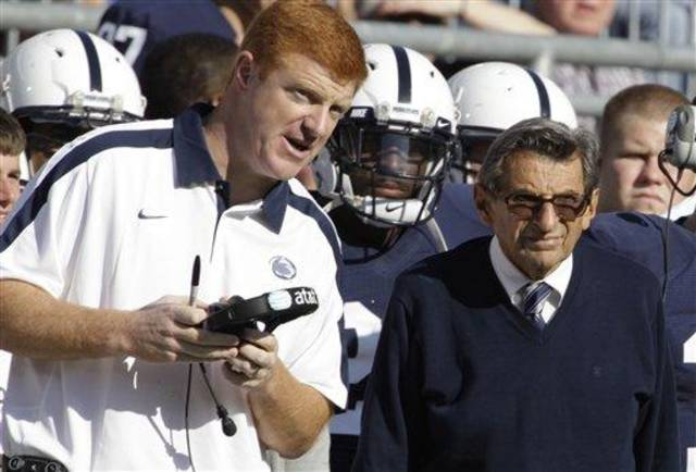 In this photo taken Oct. 8, 2011, Penn St. assistant football coach Mike McQueary, left, talks with head coach Joe Paterno during an NCAA college football game against  Iowa in State College, Pa., Saturday, Oct. 8, 2011. (AP Photo/Gene Puskar)