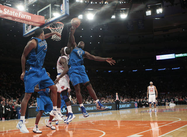 Dallas Mavericks' Elton Brand (42) blocks a shot by New York Knicks' Ronnie Brewer during the first half of an NBA basketball game Friday, Nov. 9, 2012, in New York. (AP Photo/Frank Franklin II)