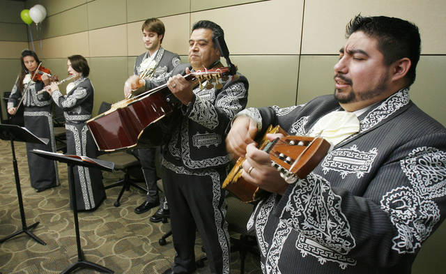 Robert Ruiz, with the mariachi band Mariachi Orgullo, plays during an opening celebration for the new offices of the Hispanic Chamber of Commerce on SW 59th and Walker in Oklahoma City, OK, Friday, Jan. 30, 2009. BY PAUL HELLSTERN, THE OKLAHOMAN