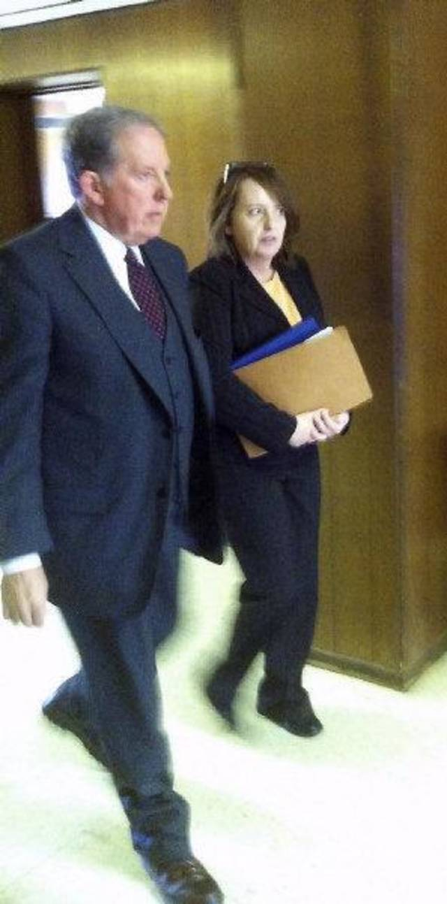 Garvin Isaacs, Parker's attorney, and Bobbi Parker leaving the courtroom for lunch in Mangum, Oklahoma Wednesday, July 6, 2011. Photo by Penny Owen, for The Oklahoman  ORG XMIT: KOD