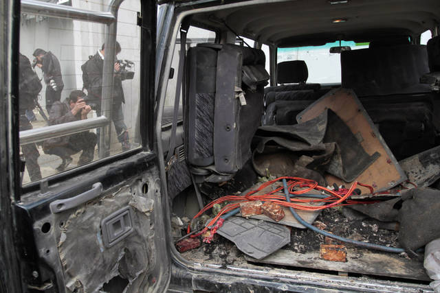 Explosive materials are seen in the back of a vehicle used by an insurgent at the site where he was shot to death  in Kabul, Afghanistan, Sunday, Feb. 24, 2013. A series of early morning attacks hit eastern Afghanistan Sunday, with three separate suicide bombings in outlying provinces and a shootout between security forces and a would-be attacker in the capital city of Kabul.  (AP Photo/Musadeq Sadeq)
