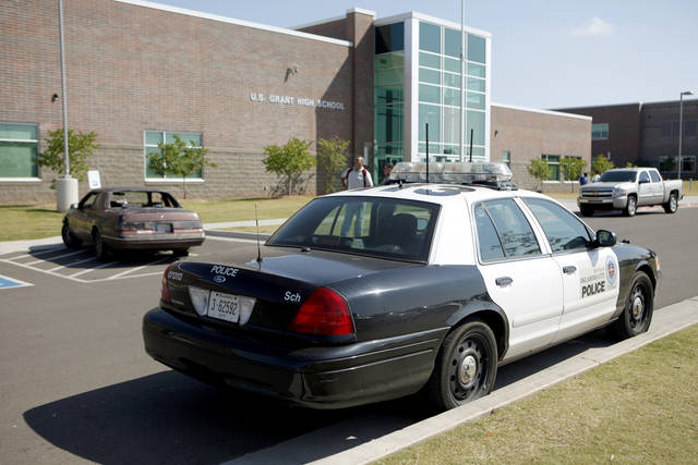 An Oklahoma City Police car sits outside U.S. Grant High School after a car that was shot parked at the school on Wednesday, September 20, 2009. Photo by Bryan Terry, The Oklahoman