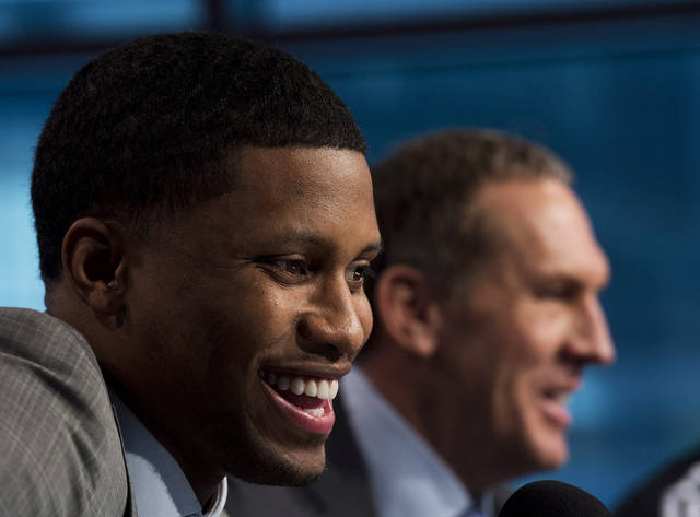 Toronto Raptors newly-acquired forward Rudy Gay, left, laughs with Raptors president and general manager Bryan Colangelo, right, during an NBA basketball press conference in Toronto on Friday, Feb. 1, 2013. (AP Photo/The Canadian Press, Nathan Denette)