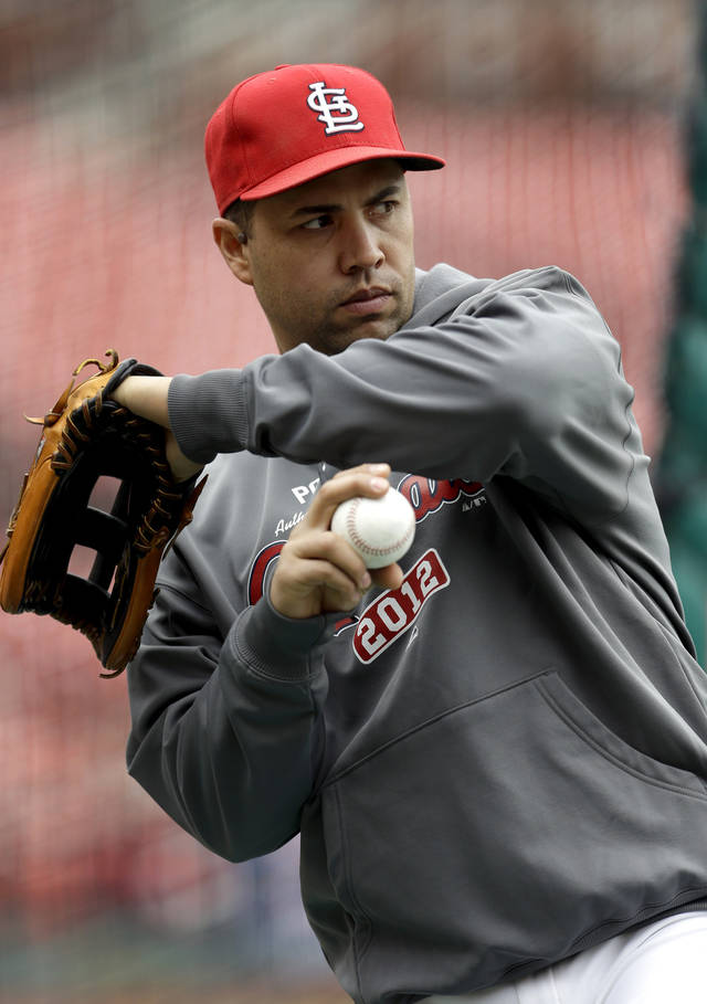St. Louis Cardinals' Carlos Beltran warms up during baseball practice Saturday, Oct. 6, 2012, in St. Louis. The Cardinals and Washington Nationals are scheduled to play Game 1 in the National League division series on Sunday. (AP Photo/Jeff Roberson)
