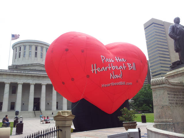 "This photo taken June 5, 2012, outside the statehouse in Columbus, Ohio, shows a large balloon in support of the Heartbeat Bill. An Ohio bill that would have imposed the most stringent restriction on abortions in the nation met its end Tuesday. Senators don't plan to vote on the so-called ""heartbeat bill"" before the end of the legislative session next month, Republican Senate President Tom Niehaus said, citing concerns the resulting law might have been found to be unconstitutional. (AP Photo/Ann Sanner)"