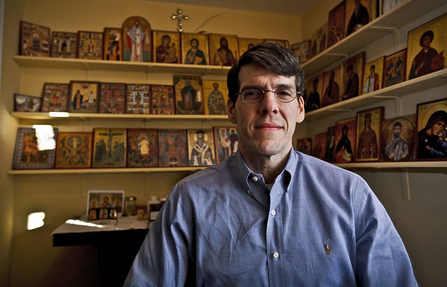 Kory Warr poses for a photo in his family's prayer-devotional room inside of his house  on Dec. 16, 2011, in Yukon, Oklahoma. Photo by Chris Landsberger