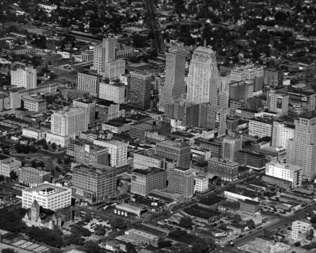 OKLAHOMA CITY / SKY LINE / OKLAHOMA / AERIAL VIEWS / AERIAL PHOTOGRAPHY / AIR VIEWS:  The day may come when elaborate turnpikes are commonplace in the southwest.  If so the trend will be based on the 88-mile double ribbon of modern highway to be dedicated and opened for business between Oklahoma City and Tulsa next Saturday.  Engineered for maximum safety and effortless driving the Turner turnpike brings to the southwest the modern transportation features previously enjoyed only in the more heavily populated areas, where they have been a success.  Photo provided by the Oklahoma City Police Department.  Photo undated and published on 05/10/1953 in The Daily Oklahoman.  Photo arrived in library on 03/03/1948.