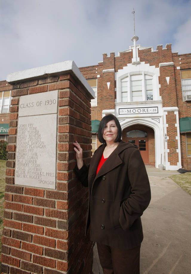 Janna Gruber, with Open Rang Archaeology, in front of the 1928 Moore school building at  201 N Broadway in Moore Thursday, Feb. 16, 2012. Photo by Paul B. Southerland, The Oklahoman