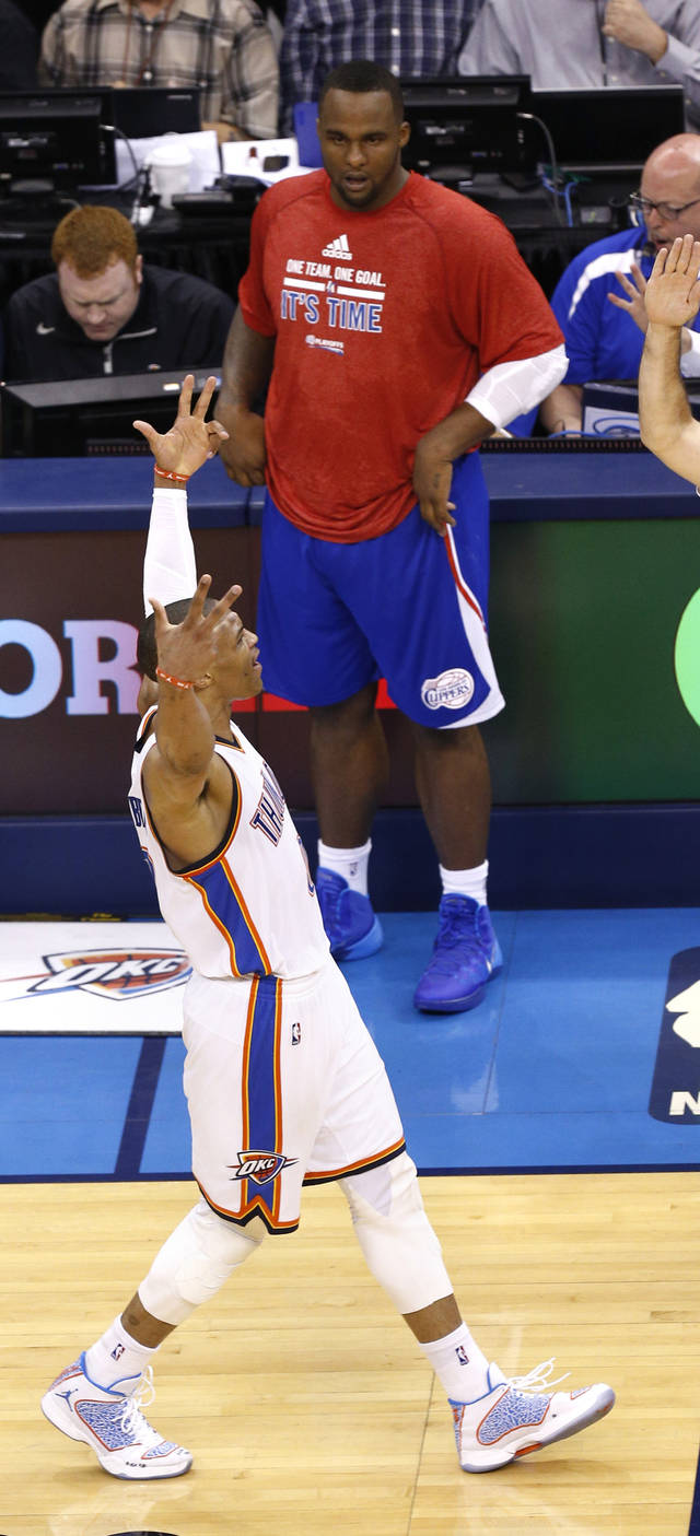 Oklahoma City's Russell Westbrook (0) celebrates a 3-pointer as Los Angeles' Glen Davis (0) looks on during Game 2 of the Western Conference semifinals in the NBA playoffs between the Oklahoma City Thunder and the Los Angeles Clippers at Chesapeake Energy Arena in Oklahoma City, Wednesday, May 7, 2014. Photo by Sarah Phipps, The Oklahoman
