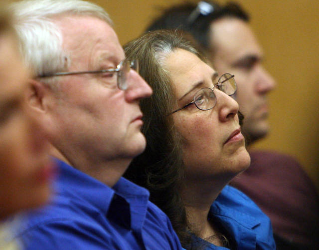 Judy Cox, center, and Chuck Cox, parents of Susan Powell, listen as Judge Ronald E. Culpepper reads the verdict in the trial of Steve Powell, Wednesday, May 16, 2012, in Tacoma, Wash. A jury convicted Powell on all 14 charges in a voyeurism case that stemmed from an investigation into the 2009 disappearance of his daughter-in-law Susan Powell, a Utah mother of two who has never been found. (AP Photo/The Salt Lake Tribune, Steve Grffin) DESERET NEWS OUT; LOCAL TV OUT; MAGS OUT