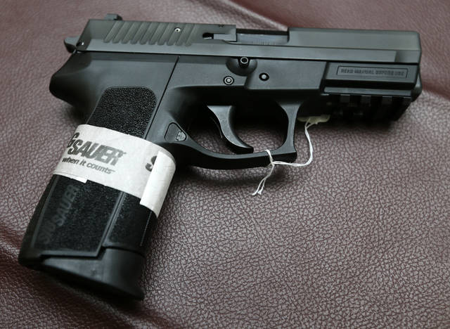 GUNS / WEAPONS: Sig Sauer 2022 handgun at Locked and Loaded, 14451 NE 23rd Street., in Choctaw, Okla., Wednesday, Jan. 16, 2013. Photo by Nate Billings, The Oklahoman