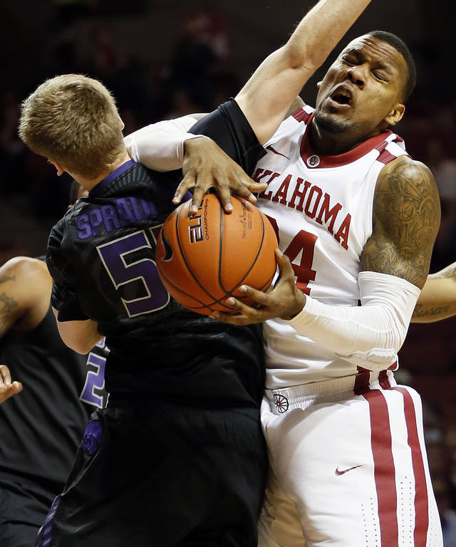 Oklahoma's Romero Osby (24) collides with Kansas State's Will Spradling (55) during an NCAA men's basketball game between the University of Oklahoma (OU) and Kansas State at the Lloyd Noble Center in Norman, Okla., Saturday, Feb. 2, 2013. Photo by Nate Billings, The Oklahoman