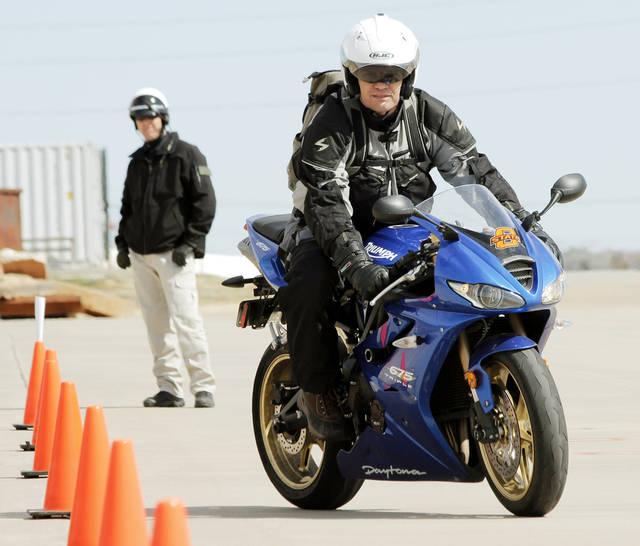 Marcus Sutliff drives his motorcycle through cones at the civilian motorcycle training course at the Edmond fire department training grounds Saturday, March 3, 2012. Photo by Doug Hoke, The Oklahoman