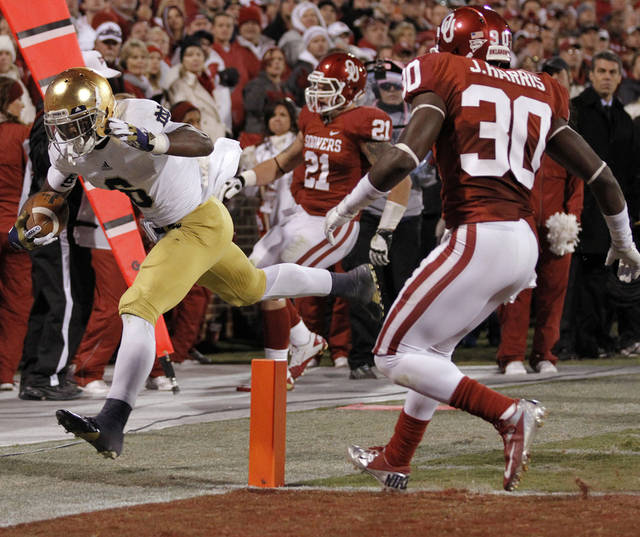 Notre Dame 's Theo Riddick (6) just misses the touchdown in front of OU's Javon Harris (30) during the college football game between the University of Oklahoma Sooners (OU) and the Notre Dame Fighting Irish at the Gaylord Family-Oklahoma Memorial Stadium on Saturday, Oct. 27, 2012, in Norman, Okla. Photo by Chris Landsberger, The Oklahoman