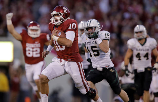 Oklahoma's Blake Bell (10) races past the Baylor defense for a touchdown during the college football game between the University of Oklahoma Sooners (OU) and Baylor University Bears (BU) at Gaylord Family - Oklahoma Memorial Stadium on Saturday, Nov. 10, 2012, in Norman, Okla.  Photo by Chris Landsberger, The Oklahoman