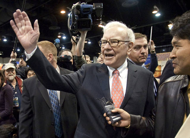 Warren Buffett, CEO of Berkshire Hathaway, waves to shareholders prior to a 2009 Berkshire Hathaway shareholders meeting in Omaha, Neb. AP Photo