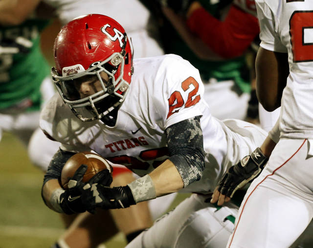 Titan running back Garrett Asher (22) dives forward as the Bishop McGuinness Irish play the Carl Albert Titans in a Class 5A semi-final playoff game at Harve Collins Field on Friday, Nov. 23, 2012  in Norman, Okla. Photo by Steve Sisney, The Oklahoman