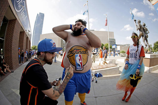 Garrett Haviland gets his stomach painted by Chase Dryden before Game 2 of the NBA Finals between the Oklahoma City Thunder and the Miami Heat at Chesapeake Energy Arena on Thursday, June 14, 2012. Photo by Bryan Terry/The Oklahoman
