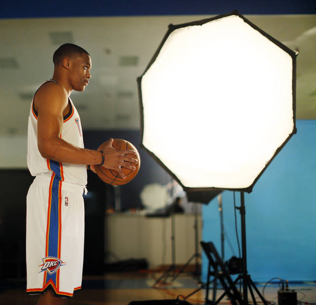Russell Westbrook has his photo taken during media day for the Oklahoma City Thunder NBA basketball team at the Thunder Events Center in Oklahoma City, Monday, Oct. 1, 2012.  Photo by Nate Billings, The Oklahoman