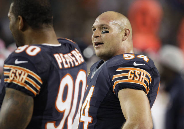 FILE - In this Oct. 22, 2012 file photo, Chicago Bears linebacker Brian Urlacher looks on from the sidelines during an NFL football game against the Detroit Lions in Chicago. Urlacher said again Thursday, Nov. 15 he would lie to cover up a concussion. With starting quarterback Jay Cutler recovering from a concussion suffered Nov. 11 in a game against the Houston Texans, the Bears' defensive star wasn't backing off comments he made to HBO earlier this year. He also said the NFL needs to do a better job protecting players' knees. (AP Photo/Nam Y. Huh, File)