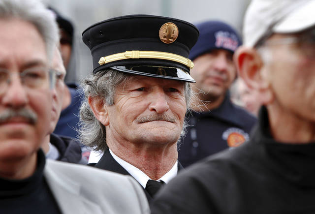 Retired Edmond firefighter Lynn L. Bourne, who served 23 years, wears his Class A uniform Monday at the state Capitol. About 400 active and retired firefighters from across the state met to express concerns to lawmakers about proposed changes in pension and workers� compensation systems. Photos by Jim Beckel, The Oklahoman