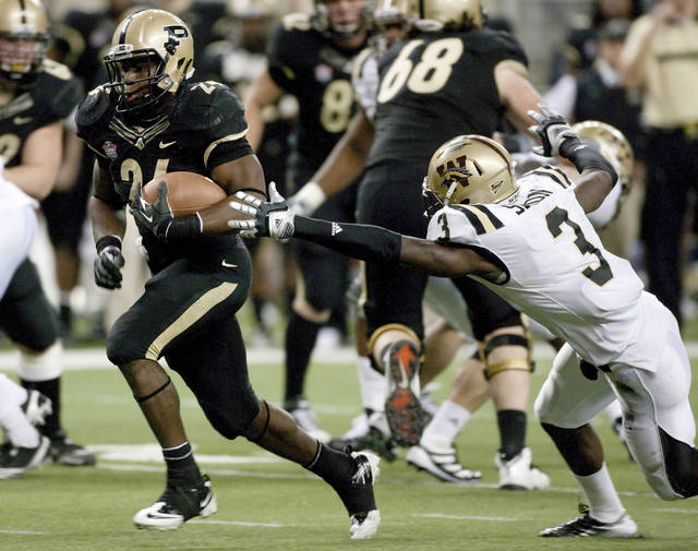 Purdue's Akeem Shavers, left, avoids Western Michigan's Johnnie Simon on a 14-yard run in the fourth quarter of the Little Caesars Pizza Bowl college football game Tuesday, Dec. 27, 2011, in Detroit. Purdue defeated Western Michigan 37-32. (AP Photo/Duane Burleson)