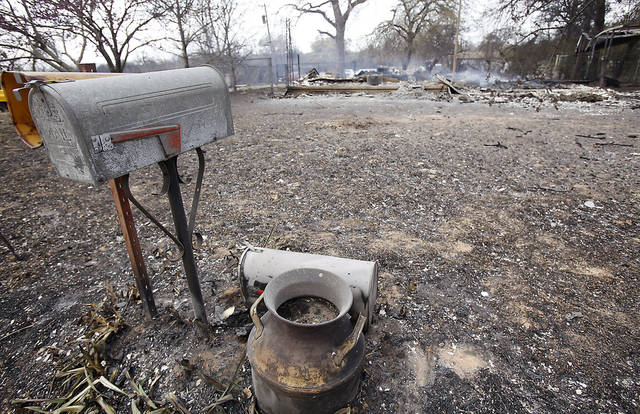 Mailboxes sit outside the remains of a smoldering home that was destroyed by wildfires on Friday, April 10, 2009, in Choctaw, Okla.  Photo by Chris Landsberger, The Oklahoman