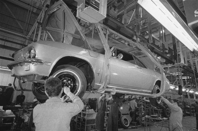 Workmen at Chevrolet's Willow Run plant finish assembling the last Corvair that General Motors will build in Willow Run, Mich., May 14, 1969. 1,710,00-rear engine Corvairs were built with the first rolling off the assembly line is the fall of 1959. The car was GM's answer to the compact movement. (AP Photo/Richard Sheinwald)