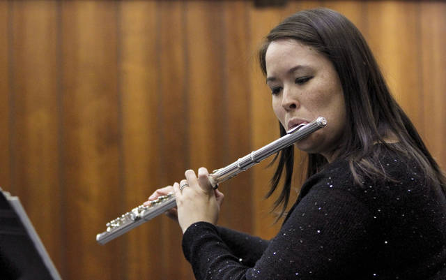 Rika Renee Hood Burr plays the flute during the Hood Family Recital at the University of Central Oklahoma Y Chapel of Song in Edmond.