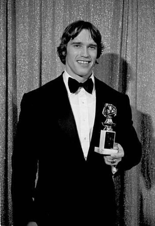 "Actor and bodybuilder Arnold Schwarzenegger is shown with his first Golden Globe award, for Best Male Acting debut in ""Stay Hungry,"" in Hollywood, Jan. 24, 1977.  (AP Photo)"