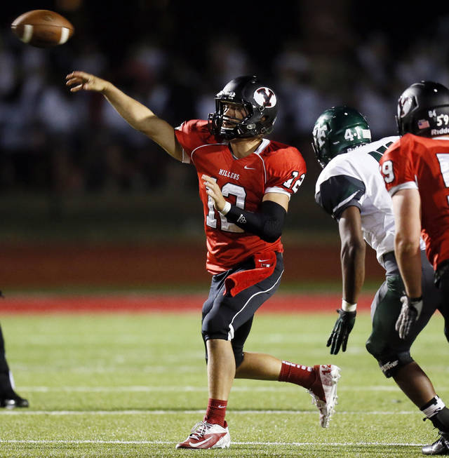 Yukon's Hayden Somerville (12) passes during a high school football game between Yukon and Edmond Santa Fe in Yukon, Okla., Friday, Sept. 7, 2012.
