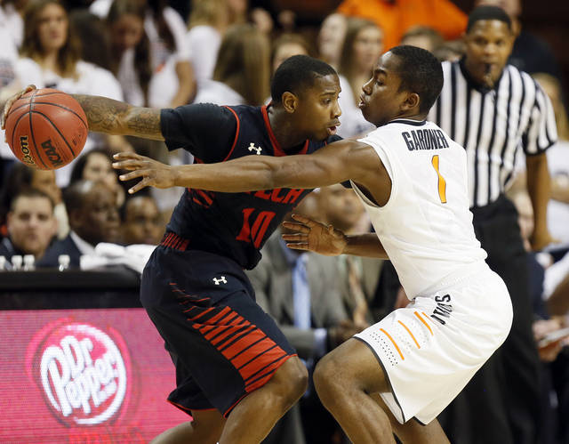 Oklahoma State's Kirby Gardner (1) guards Texas Tech's Daylen Robinson (10) during a men's college basketball game between Oklahoma State University (OSU) and Texas Tech at Gallagher-Iba Arena in Stillwater, Okla., Saturday, Jan. 19, 2013.  Photo by Nate Billings, The Oklahoman