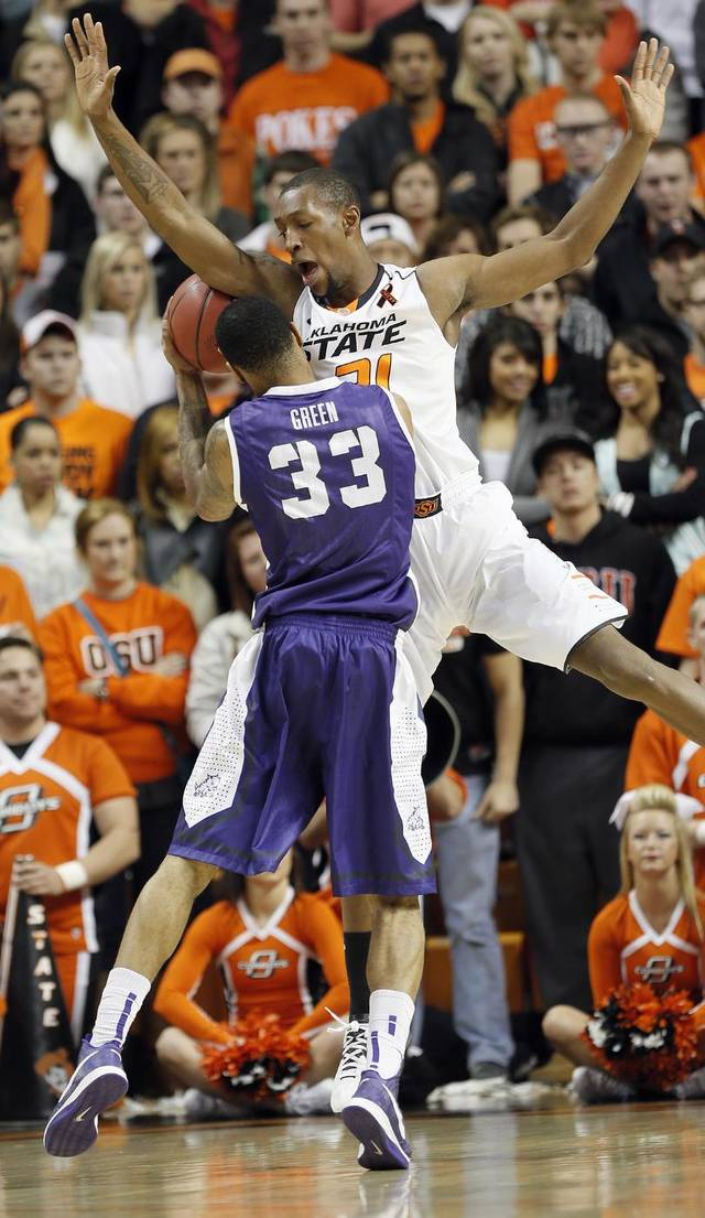 Oklahoma State's Kamari Murphy (21) defends on TCU's Garlon Green (33) during the college basketball game between Oklahoma State University Cowboys (OSU) and Texas Christian University Horned Frogs (TCU) at Gallagher-Iba Arena on Wednesday Jan. 9, 2013, in Stillwater, Okla. 