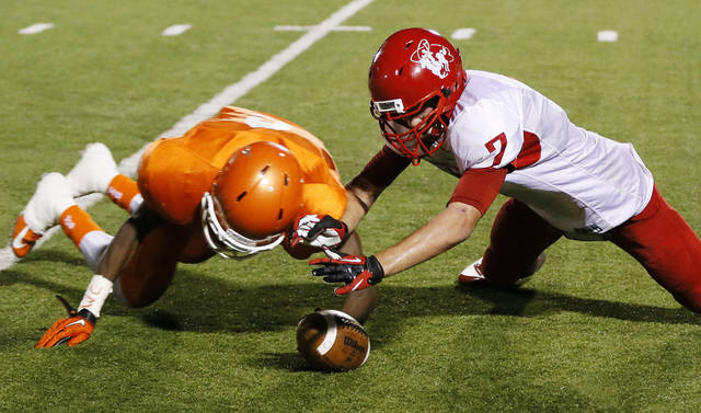 Perryton's Juan Jimenez (7) and Celina's Braylin Brown (2) chase a mishandled kick return by Jimenez during a high school football game between Texas's Celina Bobcats and Perryton Rangers in the old football stadium at Yukon Middle School in Yukon, Okla., Friday, Sept. 28, 2012. Celina recovered the ball. Photo by Nate Billings, The Oklahoman