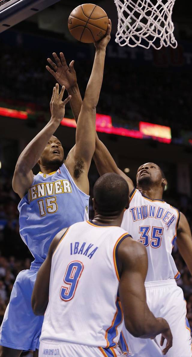 Denver's Anthony Randolph (15) drives against Oklahoma City's Kevin Durant (35) and Serge Ibaka (9) during the NBA basketball game between the Oklahoma City Thunder and the Denver Nuggets at the Chesapeake Energy Arena on Wednesday, Jan. 16, 2013, in Oklahoma City, Okla.  Photo by Chris Landsberger, The Oklahoman