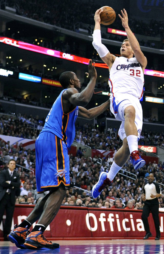 The Los Angeles Clippers' Blake Griffin, right, makes a basket over the Oklahoma City Thunder's Serge Ibaka at Staples Center in Los Angeles, California, on Tuesday, January 22, 2013. (Wally Skalij/Los Angeles Times/MCT) ORG XMIT: 1134003