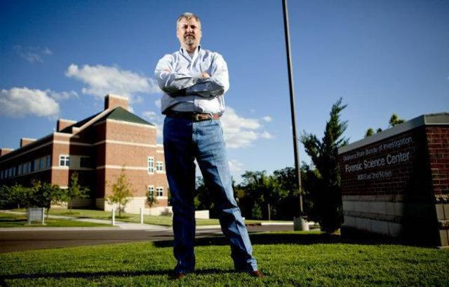 OKLAHOMA STATE BUREAU OF INVESTIGATION: Kyle Eastridge stands in front of the OSBI building in Edmond, Okla., Thursday, July 22, 2010.  Photo by Bryan Terry, The Oklahoman ORG XMIT: KOD