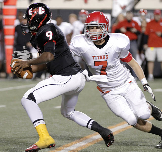 Carl Albert's Chevin Noone (7) chases down East Central's Trevaughn Cherry (9) during the Class 5A Oklahoma state championship football game between Carl Albert High School and Tulsa East Central High School at Boone Pickens Stadium on Saturday, Dec. 1, 2012, in Stillwater, Okla.   Photo by Chris Landsberger, The Oklahoman