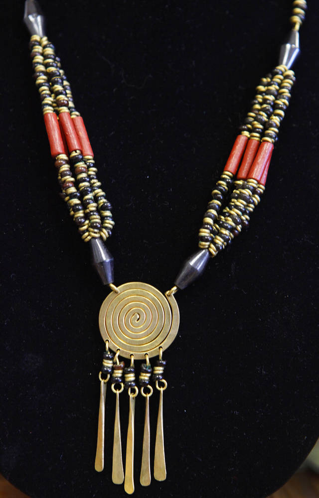 This necklace from Kenya is one of the items for sale at Pambe Ghana Global Market. Photo By David McDaniel, The Oklahoman. <strong>David McDaniel - The Oklahoman</strong>