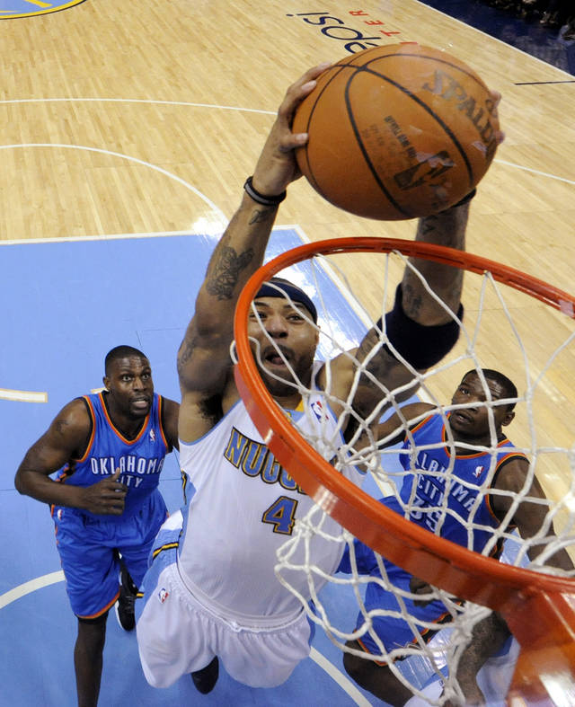 Denver Nuggets forward Kenyon Martin (4) dunks against the Oklahoma City Thunder during the first half of game 3 of a first-round NBA basketball playoff series Saturday, April 23, 2011, in Denver. (AP Photo/Jack Dempsey)