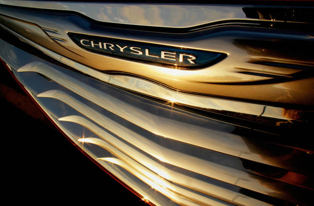 FILE - In this photo taken July 24, 2011, a setting sun is reflected in the front grill of a new Chrysler for sale at the Chrysler dealership in Springfield, Ill. Chrysler says its profit jumped to $1.7 billion in 2012 as sales rose 18 percent.  Chrysler's profit was nine times higher than the $183 million recorded in 2011. (AP Photo/Seth Perlman, File)