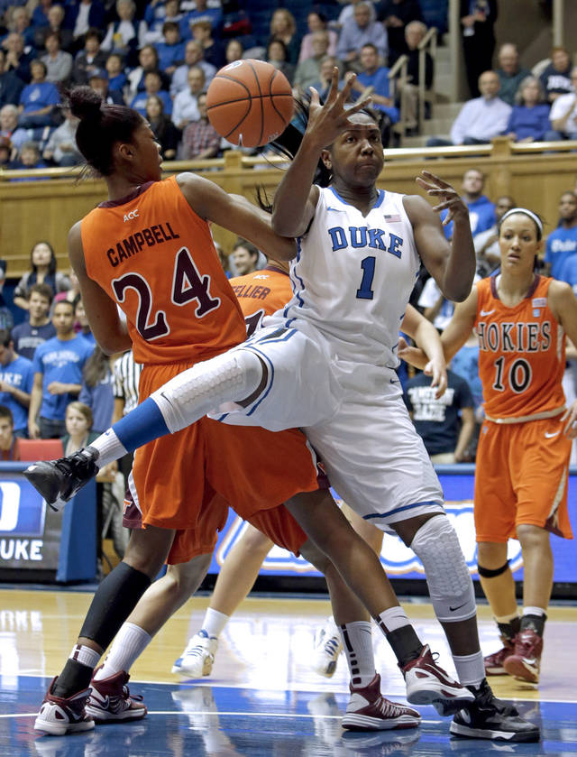 Duke&#039;s Elizabeth Williams (1) and Virginia Tech&#039;s Taijah Campbell (24) reach for a rebound during the first half of an NCAA college basketball game in Durham, N.C., Wednesday, Jan. 16, 2013. Duke won 58-26. (AP Photo/Gerry Broome)