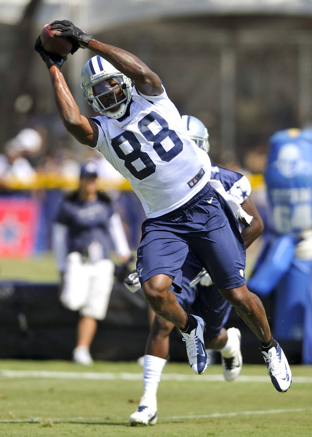 Dallas Cowboys wide receiver Dez Bryant (88) makes a catch past cornerback Morris Claiborne, rear, during NFL football training camp, Tuesday, July 31, 2012, in Oxnard, Calif. (AP Photo/Gus Ruelas)