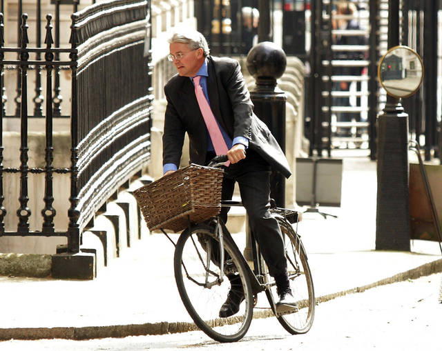 "FILE - A May 17, 2011 photo from files showing Government chief whip Andrew Mitchell arriving on his bicycle at Downing Street, London. The British Cabinet minister has apologized for an outburst in which he reportedly called police officers ""plebs"" — a derogatory term for the working class that has reinforced impressions of government elitism. Chief Whip Andrew Mitchell said Monday, Sept. 24, 2012, he didn't show the police the amount of respect he should have when an officer asked him to get off his bicycle to pass through the gates of Downing Street. However, he insists he didn't use the words attributed to him. (AP Photo/PA, Yui Mok, File) UNITED KINGDOM OUT NO SALES NO ARCHIVE"