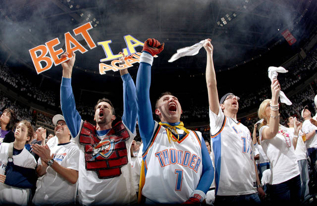 Oklahoma City fans cheer before the NBA basketball game between the Los Angeles Lakers and the Oklahoma City Thunder in the first round of the NBA playoffs at the Ford Center in Oklahoma City, Saturday, April 24, 2010. Photo by Sarah Phipps, The Oklahoman