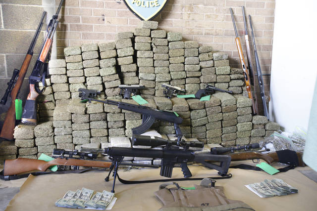 Edmond Police recovered 800 pounds of marijuana, $10,000 and guns from a residence in Edmond, OK, Tuesday, Sept. 27, 2011. By Paul Hellstern, The Oklahoman