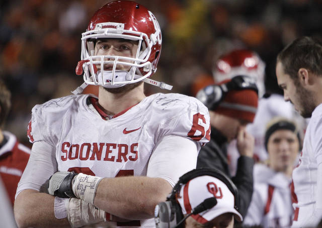 Oklahoma's Gabe Ikard (64) looks on in the final minute of the Sooners 44-10 loss to OSU during the Bedlam college football game between the Oklahoma State University Cowboys (OSU) and the University of Oklahoma Sooners (OU) at Boone Pickens Stadium in Stillwater, Okla., Saturday, Dec. 3, 2011. Photo by Chris Landsberger, The Oklahoman