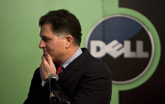 FILE - In this Thursday, March 26, 2009 file photo, Michael Dell, Chairman and CEO of Dell Inc., reacts to a question during a news conference in Beijing. Dell said Monday, March 25, 2013, that a special board committee plans to negotiate with Blackstone Group and activist investor Carl Icahn over new acquisition bids for the computer maker that rival an offer of more than $24 billion from an investor group that includes founder Michael Dell. (AP Photo/Alexander F. Yuan, File)